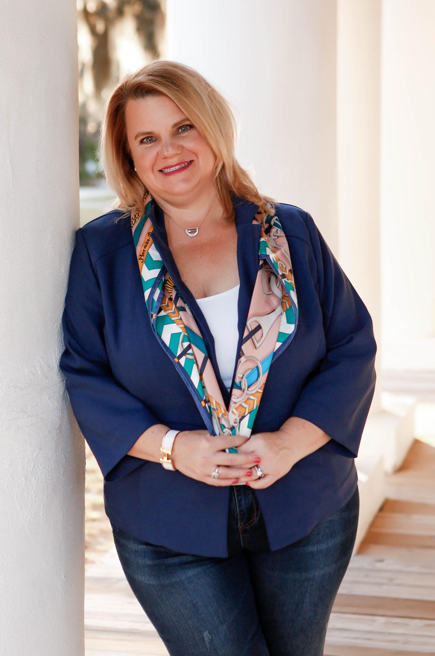 Lisa Marie Runfola in blue leaning against a column